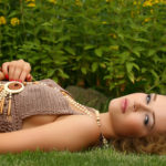attractive young woman lying on grass
