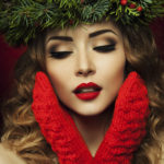 Christmas Woman. Beautiful Christmas wreath. New Year.